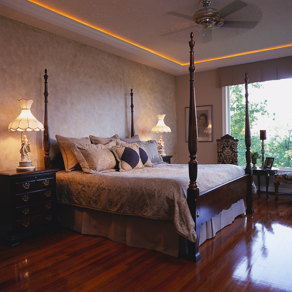 Bedroom with Four Post Bed and Wood Floors