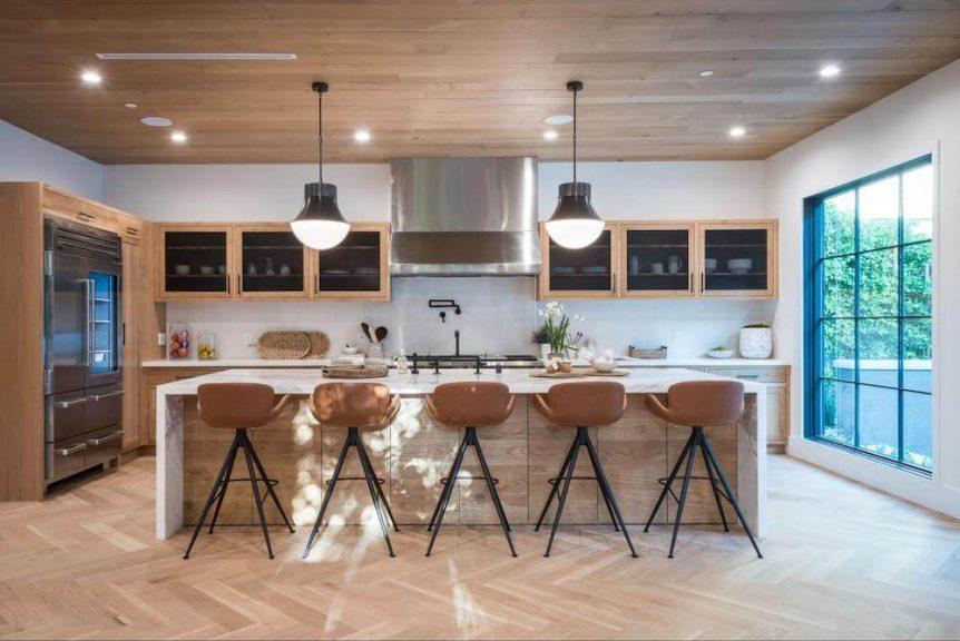 large kitchen island with bar stools